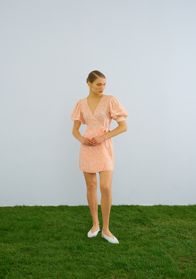 Peach print wrap dress belt detail